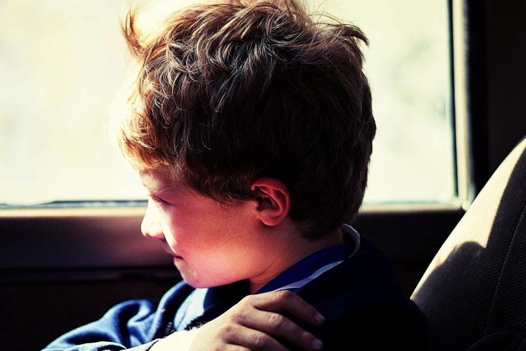 boy in blue jacket sitting next to vehicle window 918806 1 1024x683 - جزبات اور سوالات